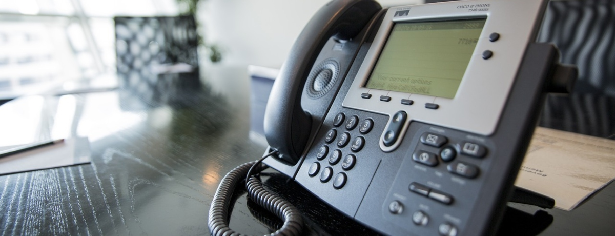 Office phone on table Image by websubs from Pixabay