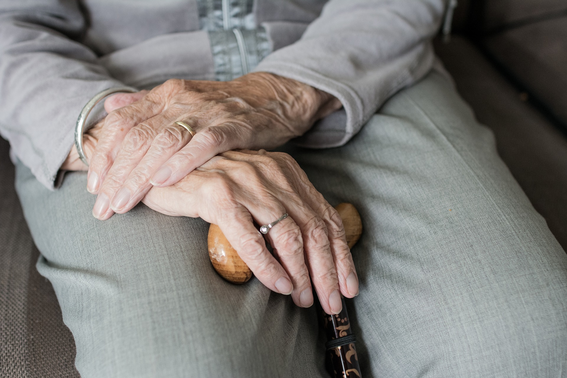Hands of elderly woman holding cane Image by Sabine van Erp from Pixabay