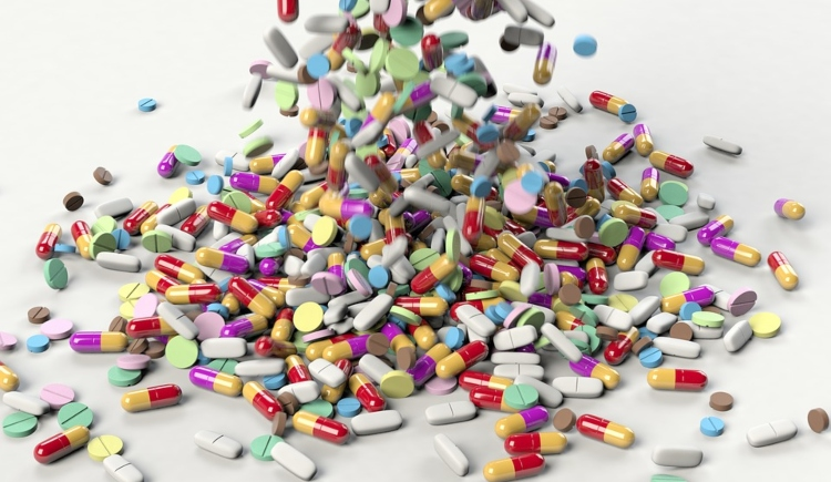 Various Pills Spilling onto the Screen